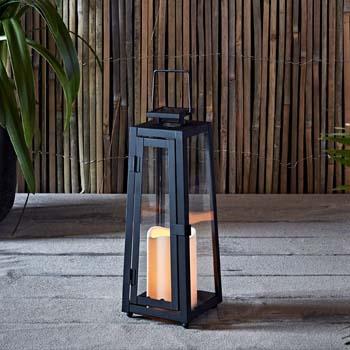 7: Lights4fun, Inc. Black Metal Solar Powered LED Fully Weatherproof Outdoor Garden & Patio Flameless Candle Lantern